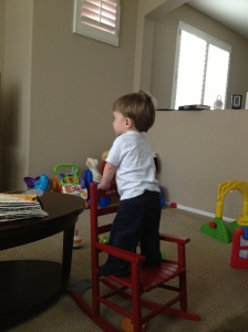 z standing on chair